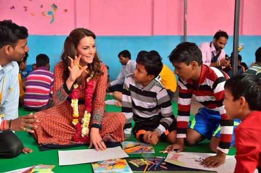 Catherine, Duchess of Cambridge participates in an arts class with street children in New Dehli, India. (Photo by Dominic Lipinski - Pool/Getty Images)