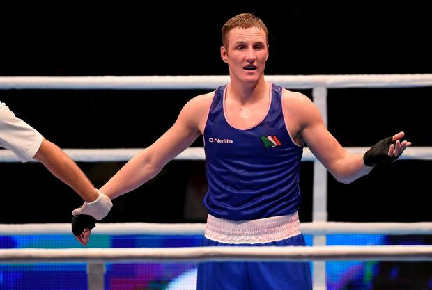 Ireland's Michael O'Reilly reacts after being beaten by Hosam Abdin in their Men's Middleweight 75kg Box-Off bout. Picture: Paul Mohan / SPORTSFILE