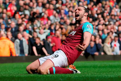 Andy Carroll celebrates after completing his hat-trick against Arsenal. Photo: AP Photo/Tim Ireland