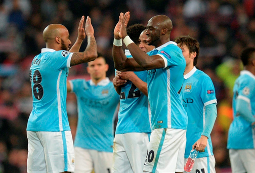 Manchester City's English midfielder Fabian Delph (L) and Manchester City's French defender Eliaquim Mangala celebrats after winning the UEFA Champions league quarter-final second leg football match between Manchester City and Paris Saint-Germain at the Etihad stadium in Manchester on April 12, 2016. / AFP PHOTO / OLI SCARFFOLI SCARFF/AFP/Getty Images