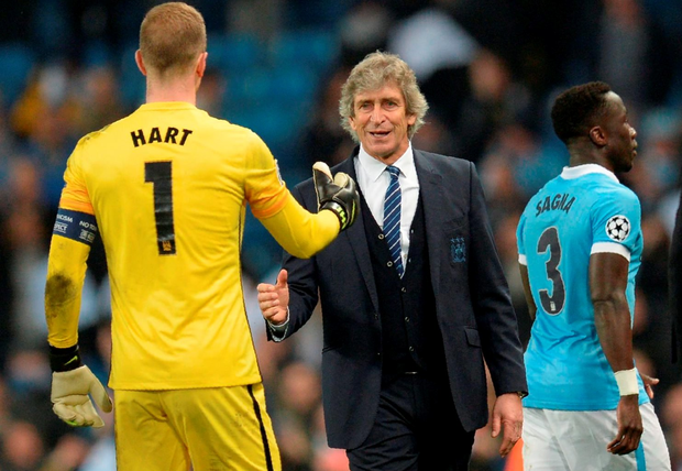 Manchester City's Chilean manager Manuel Pellegrini (C) congratulates Manchester City's English goalkeeper Joe Hart (L) after winning the UEFA Champions league quarter-final second leg football match between Manchester City and Paris Saint-Germain at the Etihad stadium in Manchester on April 12, 2016. / AFP PHOTO / OLI SCARFFOLI SCARFF/AFP/Getty Images