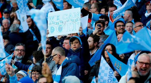 Manchester City fans raise their voices prior to kick off. Photo: Reuters / Darren Staples