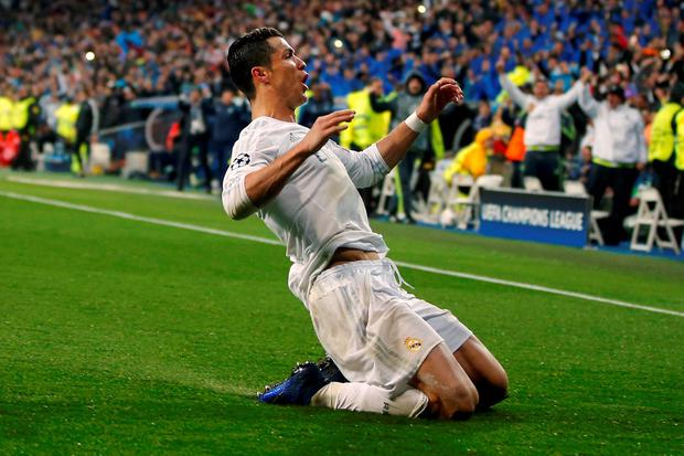 Cristiano Ronaldo celebrates scoring his third goal to send Real on their way to the Champions League Semi-Finals. (AP Photo/Paul White