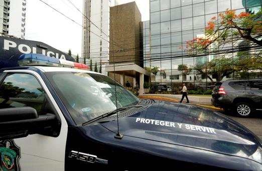 A police car stands outside the Mossack Fonseca law firm while Organized crime prosecutors raid the offices, in Panama City (AP Photo/Arnulfo Franco)
