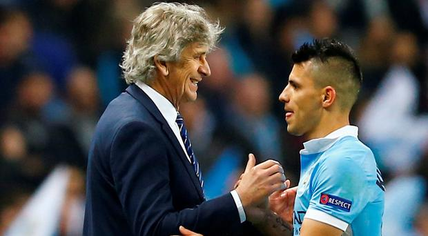 Manchester City's Sergio Aguero is congratulated by manager Manuel Pellegrini as he is substituted last night