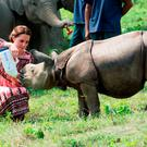 Catherine, Duchess of Cambridge feeds a baby rhinoceros during a visit to the Centre for Wildlife Rehabilitation and Conservation, at Kaziranga National Park on April 13, 2016 in Guwahati, India. The Duke and Duchess of Cambridge are on a week-long tour of India and Bhutan taking in Mumbai, Delhi, Assam, Bhutan and Agra. (Photo by Arthur Edwards - Pool/Getty Images)
