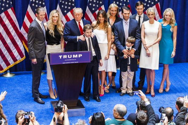 Eric Trump, Lara Yunaska Trump, Donald Trump, Barron Trump, Melania Trump, Vanessa Haydon Trump, Kai Madison Trump, Donald Trump Jr., Donald John Trump III, Jared Kushner, Ivanka Trump, and Tiffany Trump pose for photos on stage after Donald Trump announced his candidacy for the U.S. presidency at Trump Tower on June 16, 2015 in New York City. (Photo by Christopher Gregory/Getty Images)