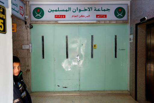 A boy who stands near the main entrance of the Muslim Brotherhood's office in Amman, after it was shut by police acting on orders of the Amman governor April 13. Reuters/Muhammad Hamed