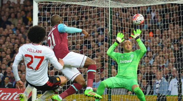 Manchester United's Belgian midfielder Marouane Fellaini (L) has a shot saved by West Ham United's Irish goalkeeper Darren Randolph during the FA cup quarter final replay football match between West Ham United and Manchester United at the Boleyn ground in London on April 13, 2016. / AFP / GLYN KIRK (Photo credit should read GLYN KIRK/AFP/Getty Images)