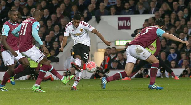 LONDON, ENGLAND - APRIL 13: Marcus Rashford of Manchester United scores their first goal during the Emirates FA Cup Sixth Round replay match between West Ham United and Manchester United at Boleyn Ground on April 13, 2016 in London, England. (Photo by Tom Purslow/Man Utd via Getty Images)