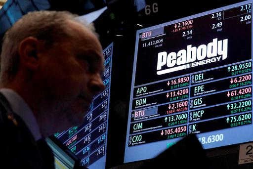 Traders work at the post where Peabody Energy is traded on the floor of the New York Stock Exchange. Photo: Reuters
