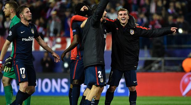 Atletico Madrid's French forward Antoine Griezmann (R) and his teammates celebrate their win during the Champions League quarter-final second leg football match Club Atletico de Madrid vs FC Barcelona at the Vicente Calderon stadium in Madrid on April 13, 2016. / AFP / GERARD JULIEN (Photo credit should read GERARD JULIEN/AFP/Getty Images)
