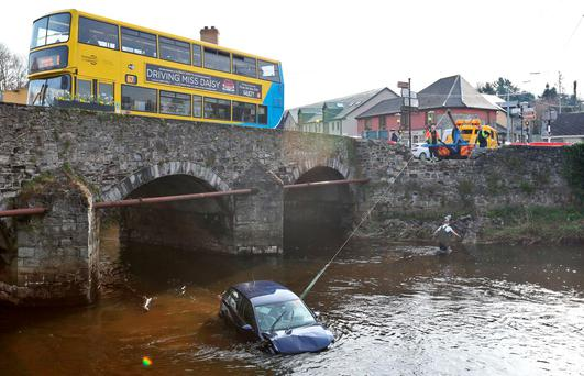 One of the cars is recovered from the Liffey at Celbridge Bridge, Co Kildare. Photo: Colin Keegan