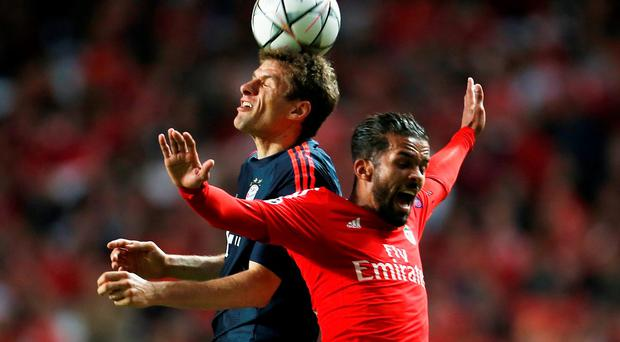 Benfica's Mehdi Carcela-Gonzalez in action with Bayern Munich's Thomas Muller. Photo: Reuters