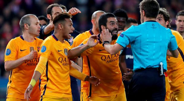 Barcelona players appeal to the referee after being denied a late penalty. Photo: Getty