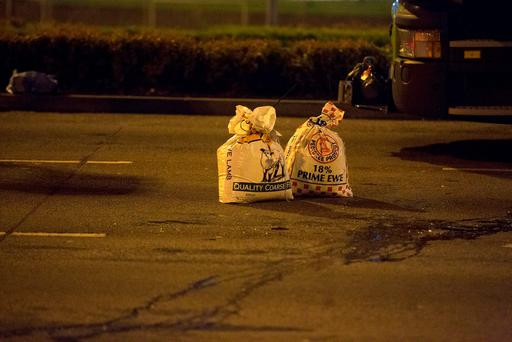 Two of the bags taken from the car by gardaí last night. Picture: Arthur Carron