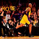 Kobe Bryant #24 of the Los Angeles Lakers reacts in the third quarter against the Utah Jazz at Staples Center on his final NBA appearance