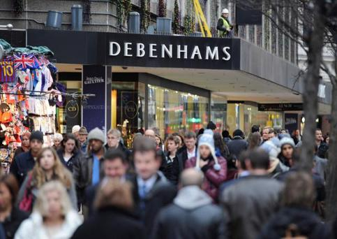 People walk past a Debenhams department store on Oxford Street, in central London. REUTERS/Ki Price