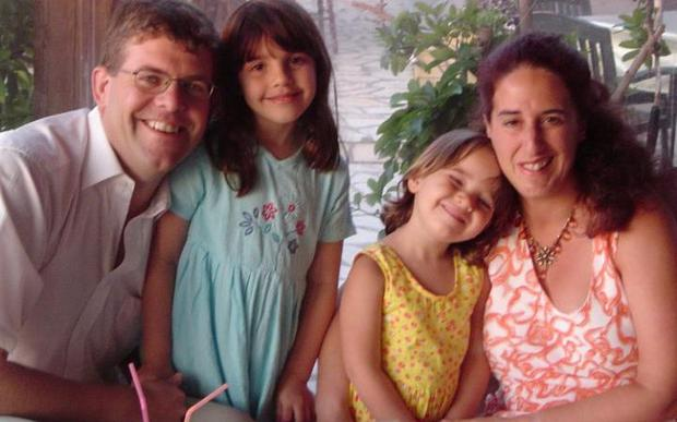 Louise, right, with her husband Alistair and children Rebecca and Natasha.
