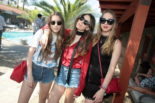 (L-R) Musicians Alana Haim, Danielle Haim, and Este Haim attend The Retreat At The Sparrows Lodge on April 11, 2015 in Palm Springs, California. (Photo by Tyler Curtis/WireImage)
