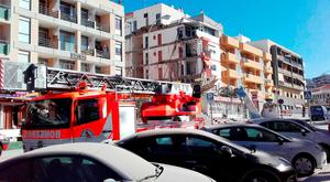 Handout photo issued by the Canarian Weekly of emergency services at the scene following the collapse of a four-storey building in Los Cristianos, Tenerife