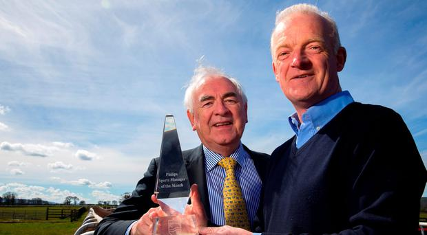 Willie Mullins receives the Philips Manager of the Month award for March from Cel O'Reilly of Philips Ireland