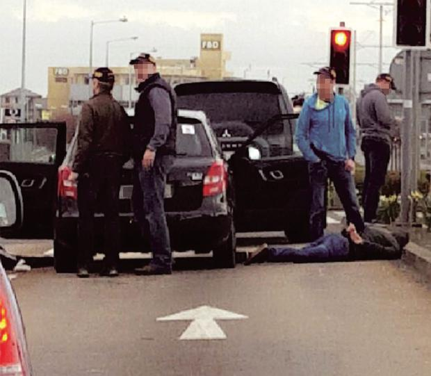 Gardai detain a suspect on the Long Mile Road