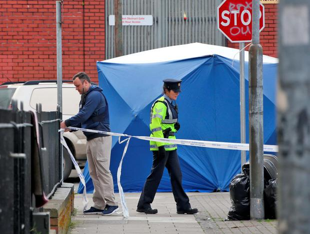 Gardai, detectives and forensic officers at the scene of the fatal shooting on Sheriff Street