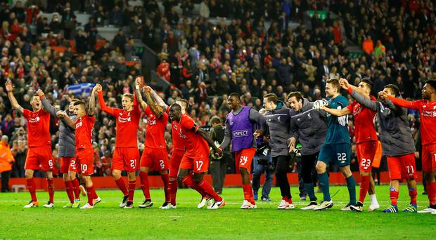 Liverpool players salute the Kop after last night's victory Photo: Reuters / Darren Staples