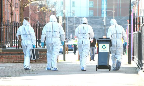 Forensic officers remove a wheelie bin on Sherriff Street in which it is believed a weapon was thrown, a man was shot outside Noctor's pub on the junction of Sheriff Street and Oriel Street near Connolly Station in Dublin