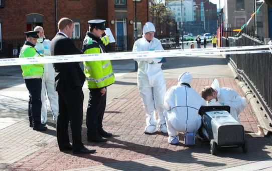 Forensic officers remove an object from a wheelie bin on Sherriff Street, a man was shot outside Noctor's pub on the junction of Sheriff Street and Oriel Street near Connolly Station in Dublin