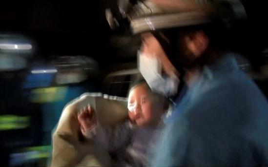 In this image made from video provided by Kumamoto Prefectural Police, Miku Nishimura, eight-month-old baby, is carried away by a firefighter after being rescued from her home collapsed by a magnitude-6.5 earthquake in Mashiki town, Kumamoto prefecture, southern Japan, early Friday, April 15, 2016