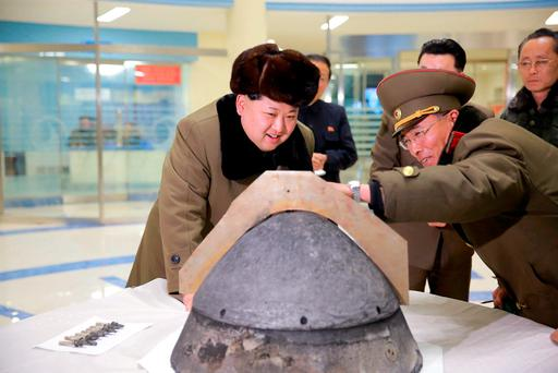 North Korean leader Kim Jong Un looks at a rocket warhead tip after a simulated test of atmospheric re-entry of a ballistic missile, at an unidentified location in this undated file photo released by North Korea's Korean Central News Agency (KCNA) in Pyongyang