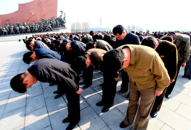 People bow in front of bronze statues of North Korea's late leaders Kim Il Sung and Kim Jong Il at Mansu Hill in Pyongyang, North Korea, Friday, April 15, 2016, to commemorate North founder Kim Il Sung's birthday