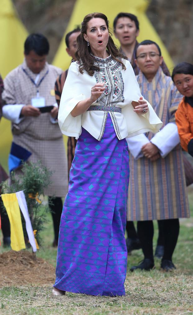 Prince William and Kate Middleton's Royal India Tour Day Five: For her second day in Bhutan, the Duchess wore a colourful skirt - handwoven in the Himalayas by local weaver Kelzang Wangmo - paired with a Paul & Joe cape and Accessorize earrings.
