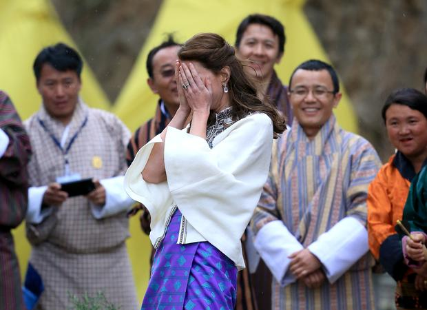 Catherine, Duchess of Cambridge throws a dart during a Bhutanese sporting demonstration on the first day of a two day visit to Bhutan on the 14th April 2016 in Paro, Bhutan. (Photo by Chris Jackson - Pool/Getty Images)