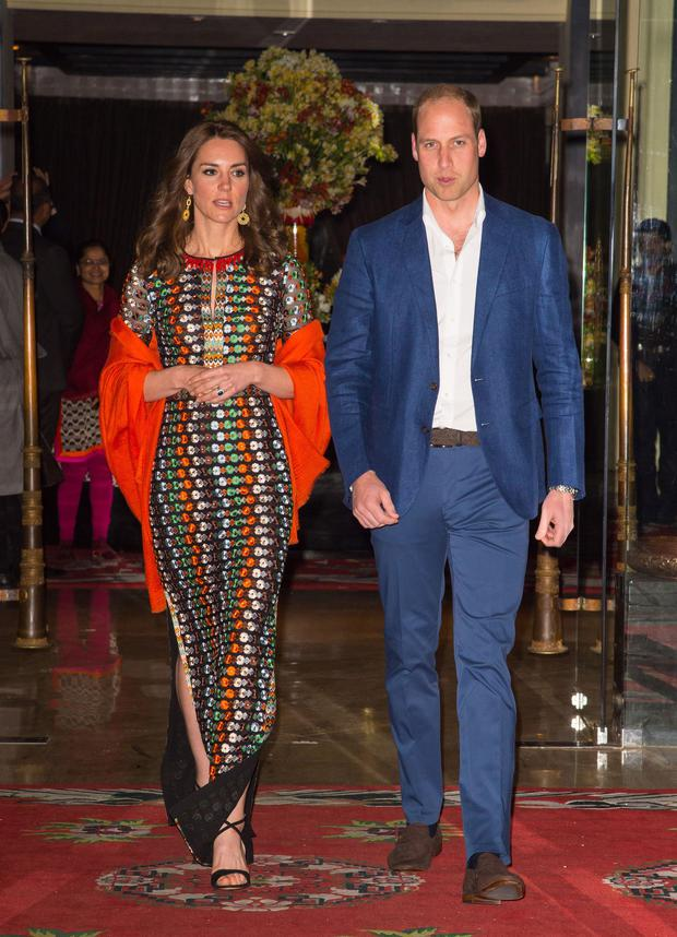 Prince William and Kate Middleton's Royal India Tour Day Five: For dinner with the King and Queen of Bhutan, she wore an embellished Tory Burch dress, an orange pashmina by Pickett London and sandals by Gianvito Rossi.