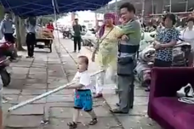 A crowd looked on amazed at the little boy's passion.