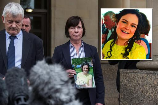 Marian Buckley holds a photo of her daughter Karen while her husband John gives a statement. Picture: Mark Condren