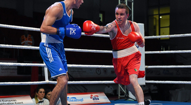 15 April 2016; David Joyce, Ireland, right, exchanges punches with Joseph Cordina, Great Britain, during their Men's Lightweight 60kg Semi-Final bout. AIBA 2016 European Olympic Qualification Event. Samsun, Turkey. Picture credit: Paul Mohan / SPORTSFILE