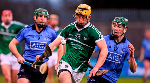 Limerick's Tom Morrissey gets away from Dublin duo Johnny McCaffrey and James Madden during their Allianz NHL quarter-final Photo: Sportsfile