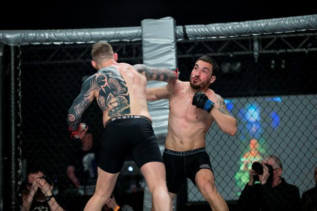 Portuguese MMA fighter Joao Carvalho (R), in the ring with Charlie Ward, before his tragic death of the father of two Photo: Dave Fogarty