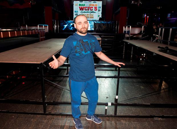 Organiser Pawel Tomczyk with the half-dismantled stage in The Wright Venue in Swords, Co Dublin, last night