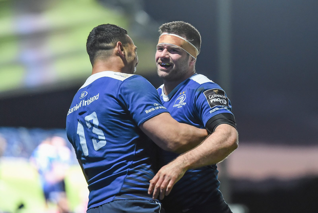 Fergus McFadden is congratulated by his Leinster team-mate Ben Te'o after scoring his side's fourth try (SPORTSFILE)