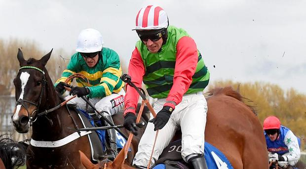 Definitly Red and jockey Danny Cook sail over the final fence on their way to claiming the featured Hillhouse Quarry Handicap Chase at Ayr yesterday (Jane Barlow/PA Wire)