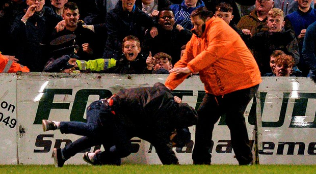 Fans from Bohemians and Shamrock Rovers clash at Dalymount Park during Rovers' victory Photo: Sportsfile