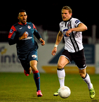 Dane Massey, Dundalk, in action against Phil Roberts, Sligo Rovers Photo: Sportsfile