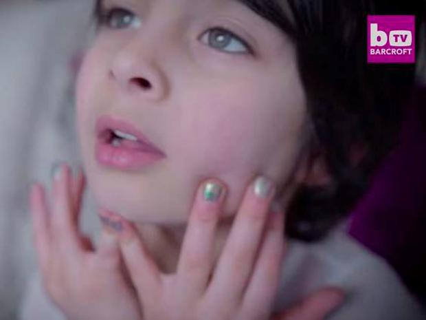 One of the twins proudly displays a sparkly manicure- the handiwork of mum Gabriella (Youtube)