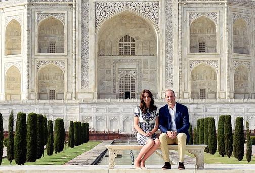 Britain's Prince William and his wife Catherine, the Duchess of Cambridge, pose as they sit in front of the Taj Mahal in Agra, India, April 16, 2016. REUTERS/Money Sharma/Pool