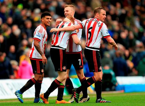 Duncan Watmore of Sunderland celebrates scoring his team's third goal with Sebastian Larsson